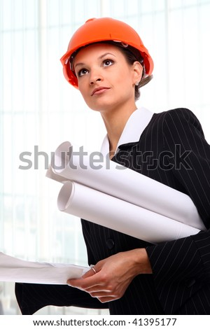 Female architect holding blueprints - stock photo