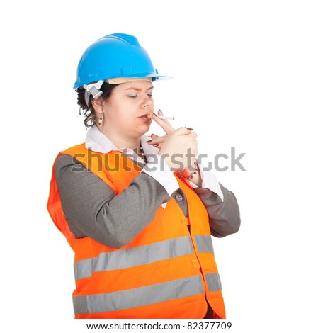female architect or engineer in orange protective waistcoat and blue helmet  preparing to smoking cigarette