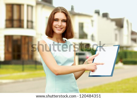 Female architect standing with folder