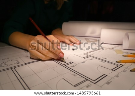 Female architect working late in evening #1485793661