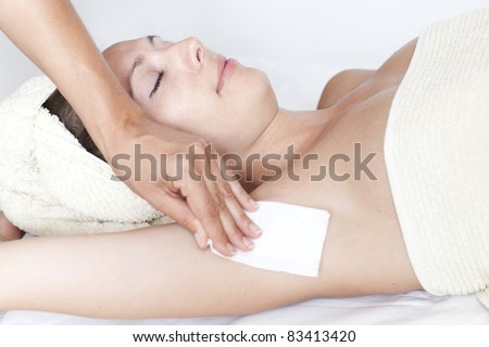 Female armpit depilation in a beauty salon