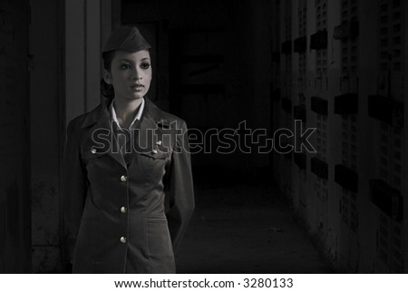 Female Army Personnel in a dark secret chamber in vintage feel