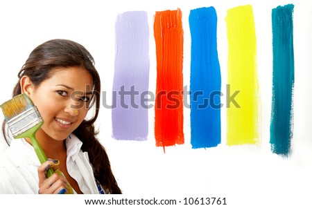 female artist choosing colours to paint the wall - isolated over a white background
