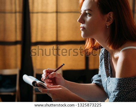 Female artist sketching. Learning to draw. Redhead woman doing pencil sketch in pad. #1325873225