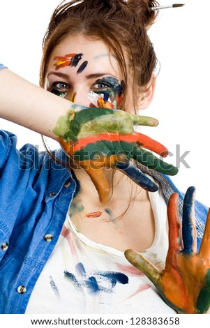 Female artist with paint smeared face and hands isolated on white background