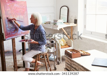 Female Artist Working On Painting In Studio #341139287