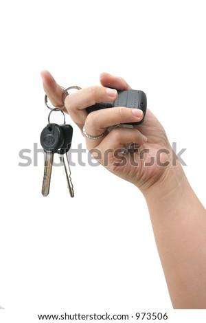 Female Asian hand holding up a set of car key by the key ring