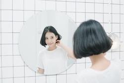 Female asian model in white room