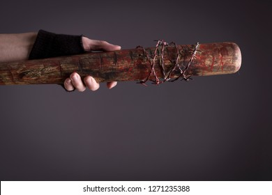 Stock photo of a female assassin with a bat, detail.