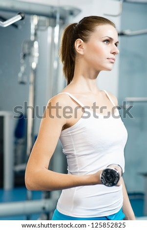 female athlete dumbbell, exercise in the fitness club