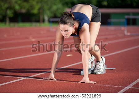 Female athlete getting ready to blast off