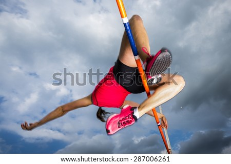 female athlete in high jump in track and field