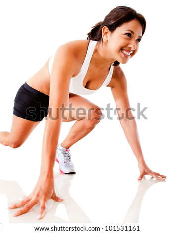 Female athlete in position ready to run - isolated over a white background