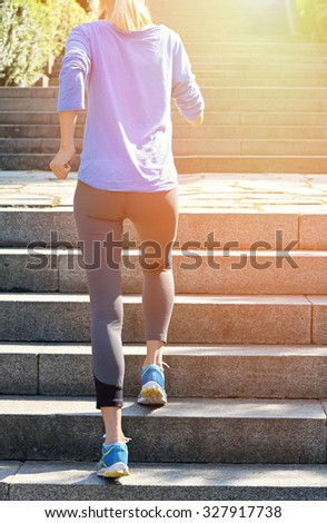 Female athlete running on stairs. Running, jogging, sport, fitness, active lifestyle concept