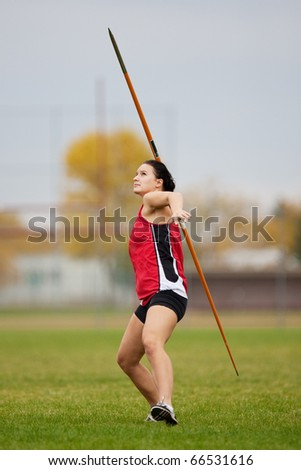 Female athlete throwing a javelin at a track and field sports event