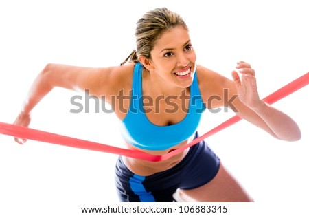 Female athlete winning the competition - isolated over a white background