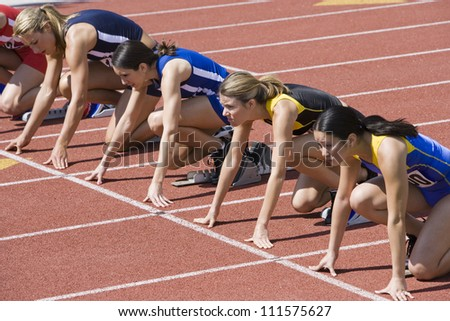 Female athletes at starting line