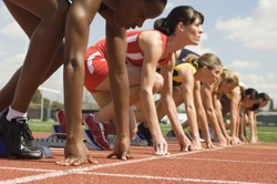 Female athletes at starting line on race track