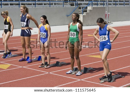Female athletes at starting line ready to race