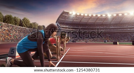 Female athletes sprinting. Women in sport clothes on starting line prepares to run at the running track in professional stadium. Muslim athlete in sports hijab