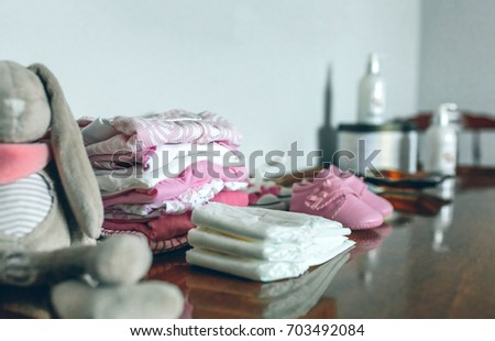 Shutterstock Female baby clothes ready for her arrival