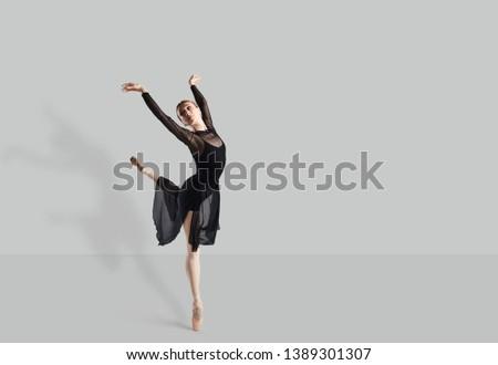 Female ballet dancer dancer over gray background. #1389301307