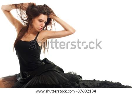 female ballet dancer in black dress holding her hair isolated on white