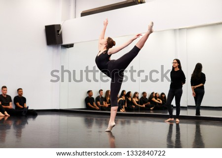 Female Ballet Student At Performing Arts School Performs For Class And Teacher In Dance Studio #1332840722