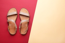 Female beige sandals on colorful background