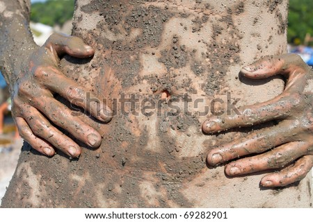 Female belly and hands covered with sea therapeutic mud - stock photo