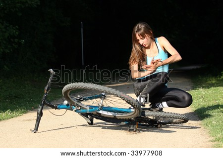 Female bike rider takes a tumble in the park