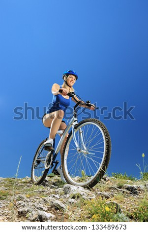Female biker biking a mountain bike outdoor