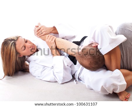 Female black belt instructor demonstrates a choke hold