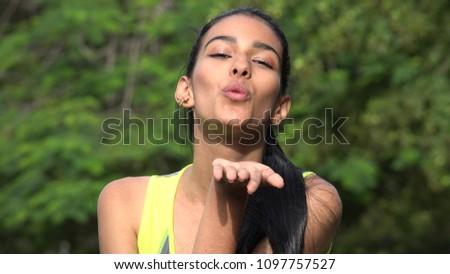 Female Blowing A Kiss #1097757527
