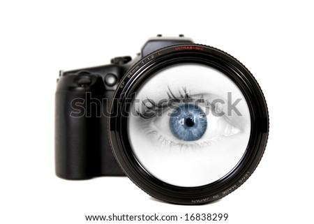Female Blue Eye Looking Through a Digital Camera Lens