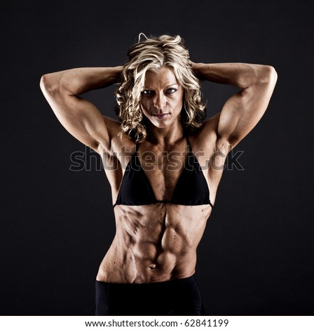 stock photo : Female bodybuilder with solid defined abs