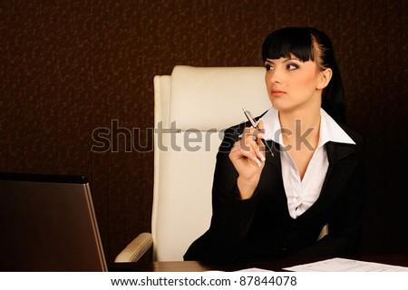 Female boss at table in office