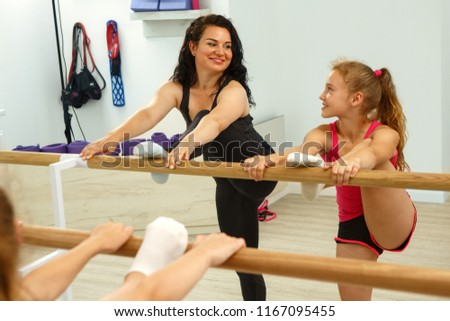Flexible little girls doing gymnastics split Images and Stock Photos