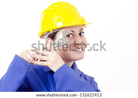 Female builder with helmet and big wrench
