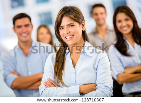 Female business leader with her team at the office