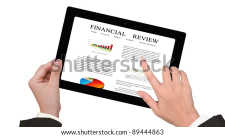 Female business person hands writing on  financial review on the touch screen device - stock photo