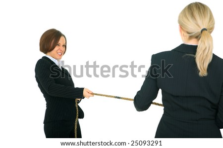 female businesswoman showing struggle face pulling rope with another businesswoman. concept for competition