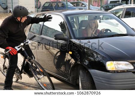 female car driver puts a...