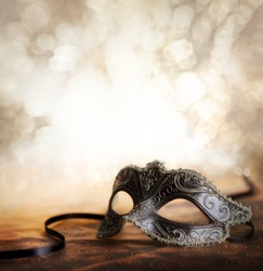 female carnival mask with glittering background