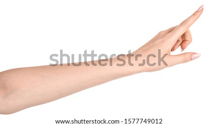 Photo of  Female caucasian hands  isolated white background showing  gesture points finger to something or someone.  woman hands showing different gestures