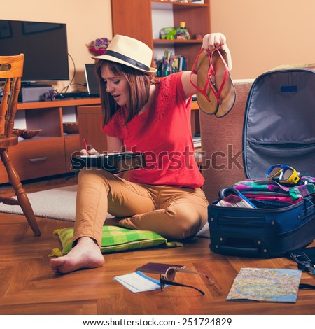 Female Checking Are There In Suitcase All Of Stuff From Packing List