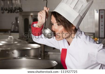 female chef tasting sauce