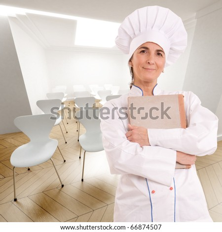 Female chef with old book in a conference room