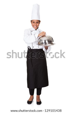 Female Chef With Tray Of Food In Hand. Isolated On White