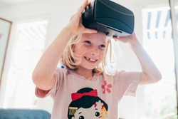 female child indoor using 3d viewer – happiness, future, video gaming concept